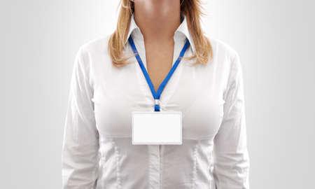 nametag: Woman wear blank white horizontal badge mockup, stand isolated. Stock Photo