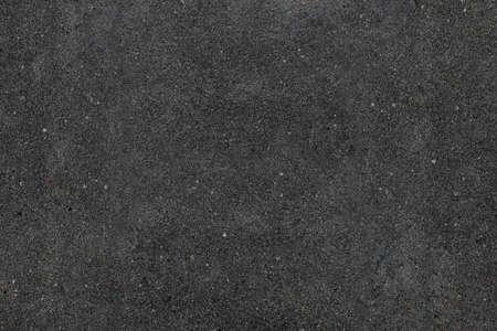 実際アスファルトのテクスチャ背景。色の暗い黒いアスファルトのパターン。粒子の粗い通り詳細灰色テクスチャ背景です。最良の方法は、あなた