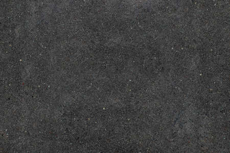 Real asphalt texture background. Coloured dark black asphalt pattern. Grainy street detail gray textured background. Best way show your design or illustration with this actual asphault photo texture. Stock Photo