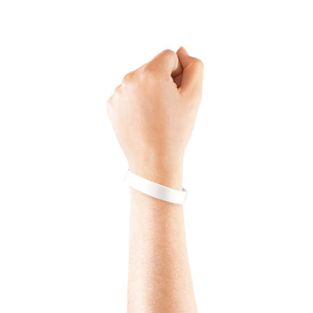Blank white rubber wristband mockup on hand, isolated.