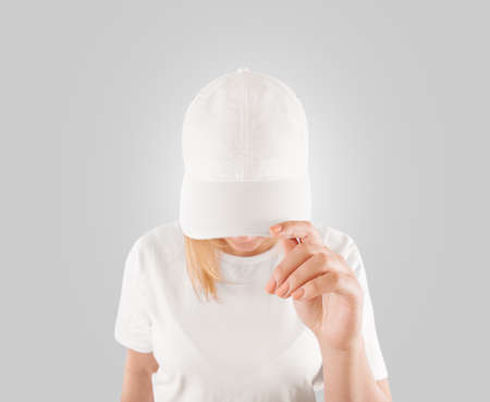 Blank white baseball cap mockup template, wear on women head, isolated Foto de archivo