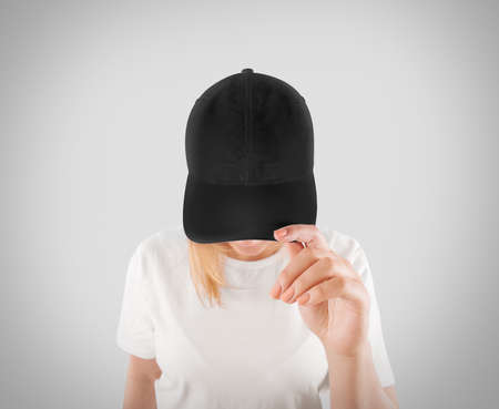 Blank black baseball cap mockup template, wear on women head, isolated, clipping path. Woman in gray hat and t shirt uniform mock up holding visor of caps. Cotton basebal cap design on delivery guy. Stock Photo - 57615738