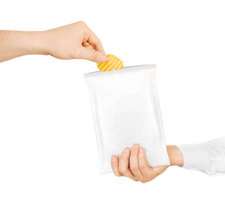 Blank white snack bag mock up hold in hand isolated. Clear white chips pack mockup. Eating chips. People treat chips and crisps. Men taking potato chips from opened packaging. Friend sharing food.