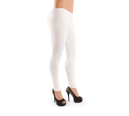 Woman wear white blank leggings mockup, isolated, clipping path. Women in clear leggins template. Cloth pants design presentation. Sport pantaloons stretch tights model wearing. Slim legs in apparel.