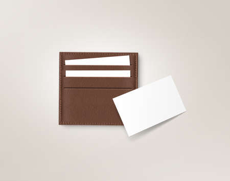 cardholder: Brown leather card holder with blank white card mock up isolated on grey. Business credit cards mockup in sleeve cardholder pocket. Clear paper employee id cards in grey wallet box. Logo design card. Stock Photo