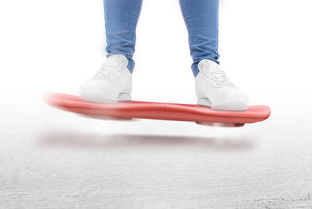 gravitation: Man moving on red hover board scooter isolated. Smart hoverboard movie scoter. No wheel futuristic transport device. Future transportation technology. driver. Person ride antigravity levitation
