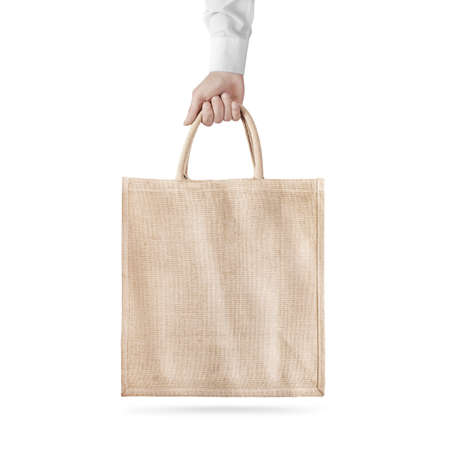 Blank cotton eco bag design mockup isolated, holding hand, clipping path. Textile cloth bag mock up template hold arm. Tote shoe consumer reusable organic craft package. Carrier recycle bag