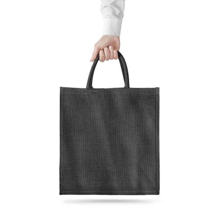 Blank black cotton eco bag design mockup isolated, holding hand