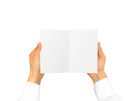 rabbet: Hand in white shirt sleeve holding blank booklet card in the hand.