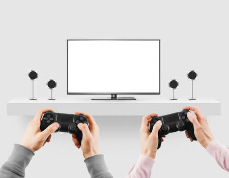 woman hanging toy: Man hold game controller in hands in front of blank tv screen mock up playing game. Stock Photo