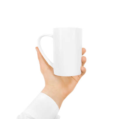 White blank mug mock up holding hand isolated on white. Empty ceramic tea cup hold handle. Clear drink mug mockup ready for logo design presentation. Teacup pot holder. Mug design texture template.