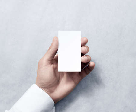 Hand holding blank vertical white business card design mockup hand holding blank vertical white business card design mockup clear calling card mock up template fbccfo Choice Image