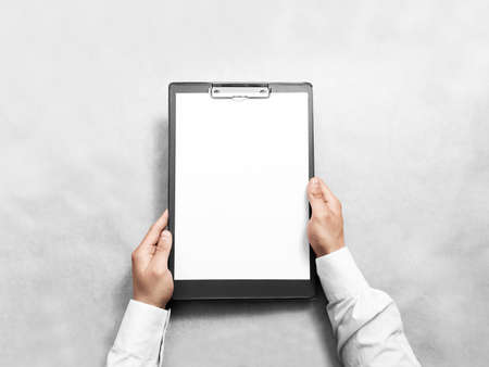 clip board: Hand holding blank clip board with white paper design mockup.
