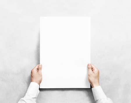 Hand holding white blank poster mockup, isolated.