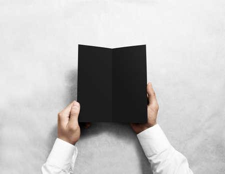 rabbet: Hand opening blank black flyer brochure booklet mockup. Stock Photo
