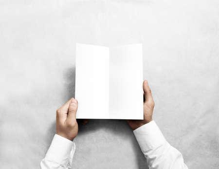 Hand opening blank white flyer brochure booklet mockup. Reklamní fotografie
