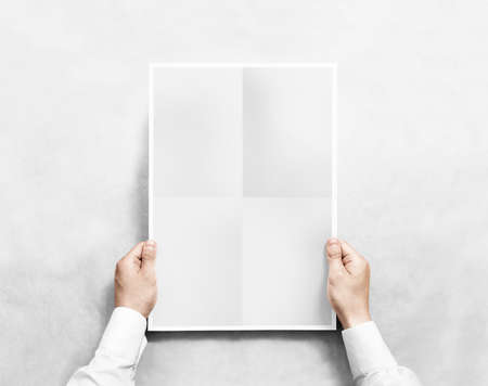 Hand holding grey blank poster mockup, isolated.