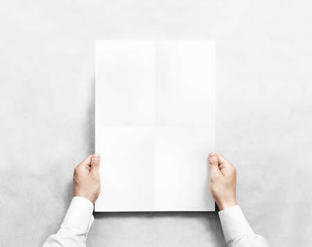 broadsheet: Hand holding white blank poster mockup, isolated. Arm in shirt hold clear broadsheet template mock up. Affiche bill surface design. Broadside pure print display show. Sticking a3 poster on the wall.