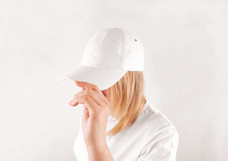 visor: Blank white baseball cap mockup template, wear on women head, isolated, side view. Woman in clear hat and t shirt uniform mock up holding visor of caps. Cotton basebal cap design on delivery guy.