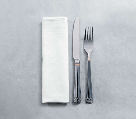 argent: Blank white restaurant napkin mockup with knife and fork, isolated. Stock Photo