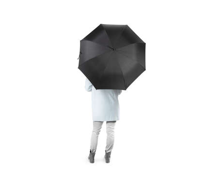 umbel: Lady stand backwards with black blank umbrella opened mockup, clipping path. Female person hold clear umbel overhead. Plain surface gamp mockup. Man holding protective accesory gingham cover handle.
