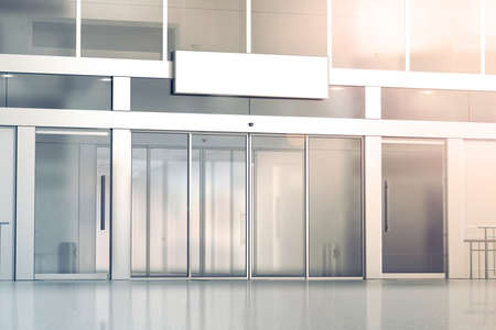 Blank white signage on the store glass doors entrance mockup, 3d rendering. Commercial building automatic entry, banner mock up. Closed transparent business centre facade, front view. Stockfoto