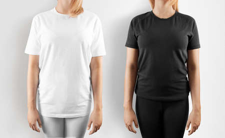 Blank black and white t-shirt design mockup, isolated. Women wear tshirt template, front view mock up. Empty apparel uniform singlet, female model. Plain sweat tee shirt dress set. Stock Photo