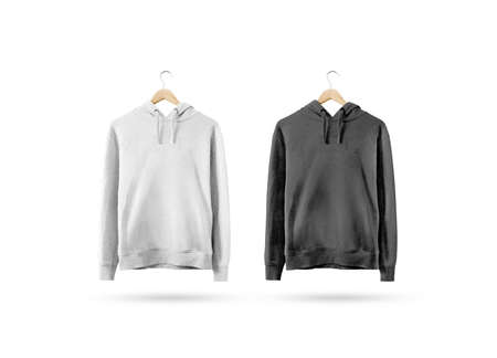 Blank black and white sweatshirt mockup hanging on wooden hanger. Empty sweat shirt mock up on rack isolated. Clear cotton hoody template. Plain textile hoodie design. Loose overall casual jumper.