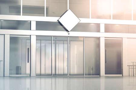 店舗ガラス引き戸の入り口、3 d レンダリングに空白の白い菱形看板モックアップ。商業ビルの自動エントリ、バナーをモックアップします。透明な 写真素材