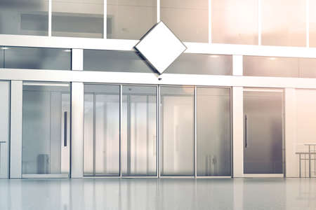 Blank white rhombus signage mockup on the store glass sliding doors entrance, 3d rendering. Commercial building automatic entry, banner mock up. Closed transparent business centre facade, front view. Banque d'images