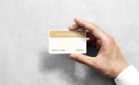 Hand hold loyalty card template with rounded corners. Plain reward namecard mock up holding arm. Plastic discount program mockup with points display. Gift offset card design. Loyal service branding.