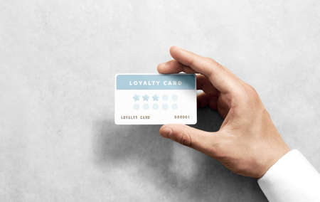 Hand hold discount card template with rounded corners. Plain reward namecard mock up holding arm. Plastic loyalty program mockup with points display. Gift offset card design. Loyal service branding.