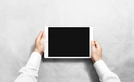 Hands holding blank tablet mock up. New portable pc screen presentation. Empty device display mockup. Space touchscreen gadget hold in arms. White hd wide screen monitor holder. Archivio Fotografico