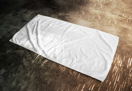 Blank white beach towel mockup on textured floor, side view. Clear unfolded wiper mock up lying on the surface.