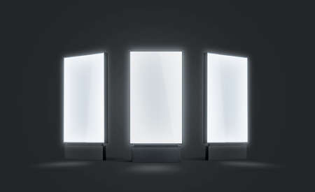 Blank white glowing pylon mock up set, isolated in darkness, 3d rendering. Empty illuminated screen mock up, different sides. Clear luminous poster for ad or affiche. Outdoor lightbox template. Stockfoto