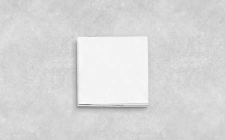 Blank white folded napkin on textured surface mockup. Empty square serviette mock up. Clear kitchen tablecloth for restaurant or dinning template. Hygiene textile towel design. Reklamní fotografie