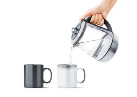 Lege zwart-witte magische mok met heet theepotmodel, geïsoleerd. Keramische beker vulwater met waterkoker in de hand mock up, vooraanzicht. Chameleon gebruiksvoorwerp voor koffie of thee met thermoprint. Stockfoto