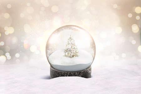 Boule à neige en verre blanc avec maquette de chutes de neige et d'arbre de Noël Banque d'images