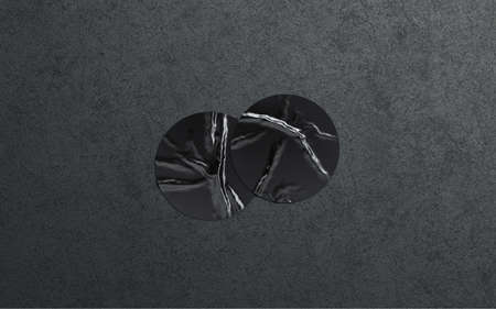 Blank two black round adhesive sticker mockup dark textured wall, 3d rendering Фото со стока