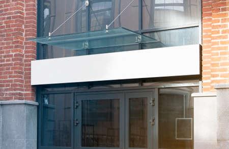 Blank white rectangular box store entrance mockup, glass brick wall