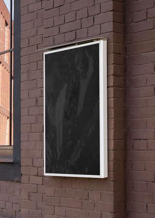 Blank black glass rectangular poster mock up brick wall mounted