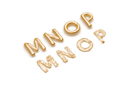 Inflated, deflated gold M N O P letters, balloon font 免版税图像