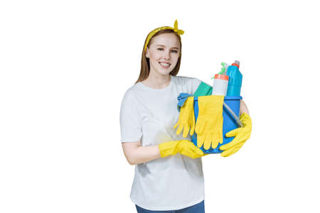 portrait of a beautiful young smiling woman with a lot of cleaning equipment on a white background studio isolate. Zdjęcie Seryjne
