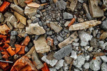 Construction garbage background. Fragments of bricks, broken tiles and pieces of plaster 版權商用圖片