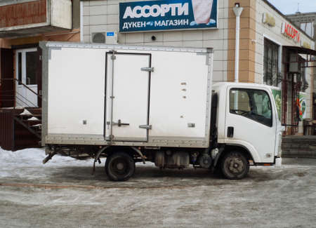Kazakhstan, Ust-Kamenogorsk, February 6, 2020: Food delivery to the grocery store. White truck. Delivery van