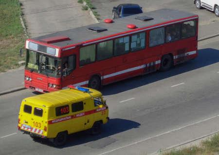 Kazakhstan, Ust-Kamenogorsk, August 11, 2019: Bus and ambulance car. Public transport and ambulance. Traffic. Cityscape 報道画像