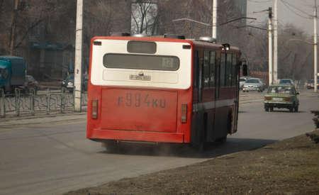 Kazakhstan, Ust-Kamenogorsk, March 29, 2019: City bus. Public transport. City traffic. Cars 報道画像