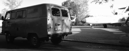 Kazakhstan, Ust-Kamenogorsk, September 10, 2019: Yak 40 airplane and Uaz 452. Open-air museum. Black and white