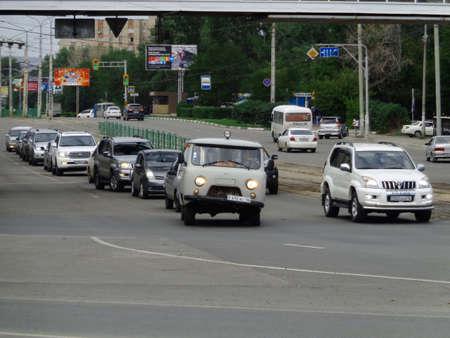 Kazakhstan, Ust-Kamenogorsk, August 9, 2019: Traffic. One of the city streets. Downtown. Street traffic. Urban landscape. Broken car 報道画像