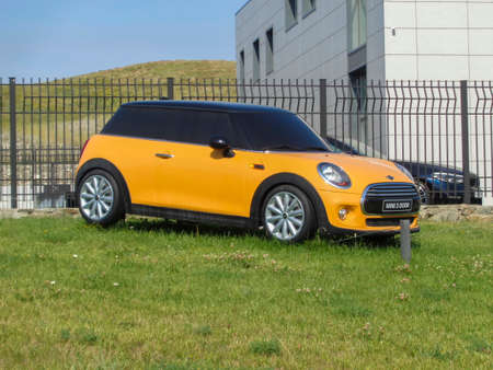 Kazakhstan, Ust-Kamenogorsk, july 18, 2019: Mini Cooper 3 Door (Advertising model). Bright yellow car 報道画像